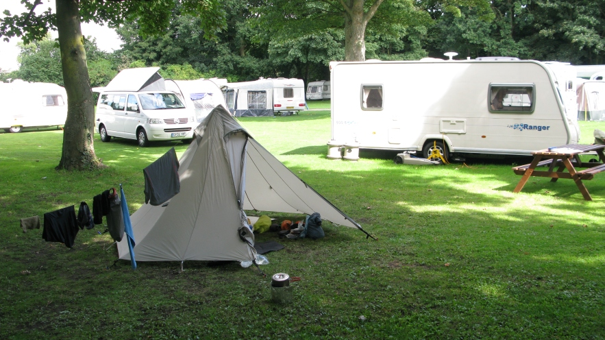 Camping on a caravan park. Wherrymans Way, 2014
