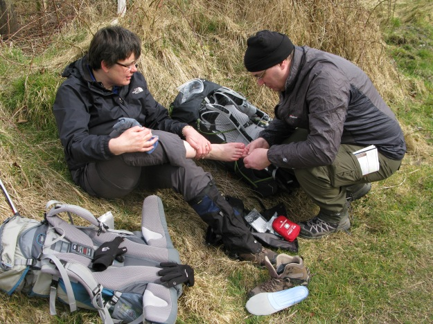 Attend to foot problems as soon as possible. A slight problem can quickly become major. This brief halt on the West Highland Way in 2014 got rid of a tiny piece of grit before anything could develop