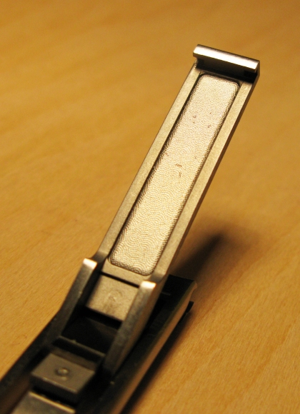 Nail file beneath top lever