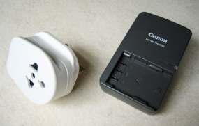 Battery charger and plug adapter