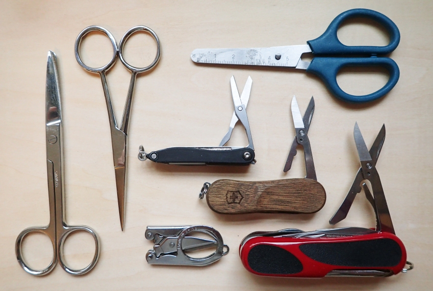 In addition to cutting the top off food pouches and gear repairs. A pair of scissors is also pretty much an essential as part of a First Aid Kit. From trimming nails to cutting gauze and plasters to fit, from trimming loose skin to shaping cushion pads. There is little that will do the job as well as a pair of scissors. You can decide to take something substantial; the largest shown here weighs 32g, or something more modest which is still a 'proper' pair of scissors. The blue handled pair weighs a more respectable 16.5g. The small folding pair weighs 14g, the large Wenger Evo 18 pocket knife a whopping 91g and the smaller Wenger Evowood 81 20g