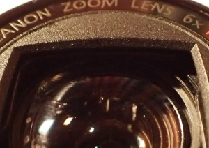 Vertical scratches on camera lens