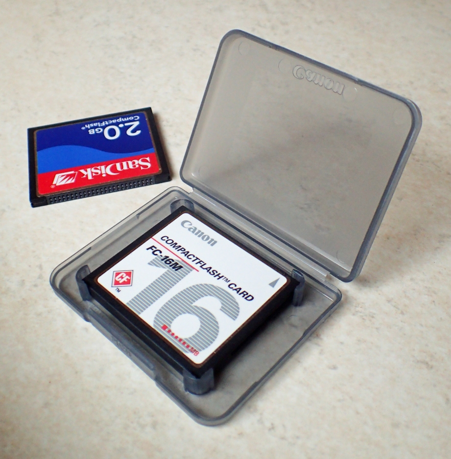 Manufactured since 1994, Compact Flash (CF) cards are a flash memory mass storage device. This is a 16 mb type I card from Canon (in plastic case) that measures 42.5mm x 36mm x 3.3mm and weighs 9.2g. Because they are solid state, the cards are both rugged and reliable however its relatively large size means that they are no longer suited to smaller cameras, being favoured more for high end hardware