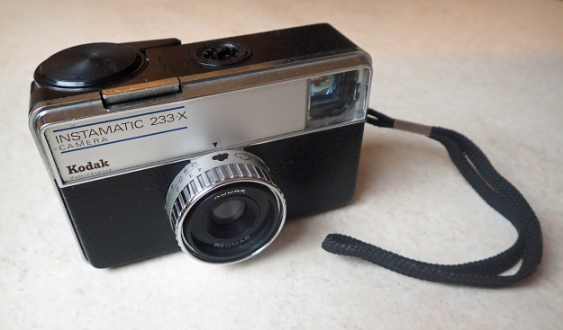 Kodak Instamatic 233-X, manufactured 1970-71. This camera came with a Reomar f/6.6, 41mm lens and 1/40, 1/80 shutter. The square format negative size was 28mm x 28mm from the 126 film cartridges.