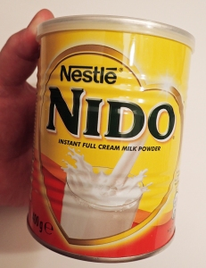 400g tin of Nido full [cream] milk powder. Larger tins are available but I have never come across them.