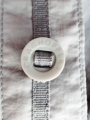 The 'Soldier '95' style buttons have been used by some outdoor clothing manufacturers but are troublesome to replcae if they are broken or lost, being designed to be fixed in place with a tape running through them