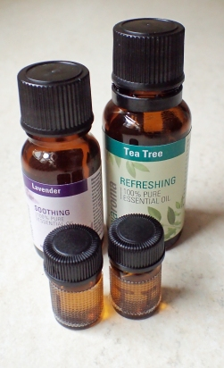 The inclusion of a couple bottles of Essential Oil can be justified by using the tiny glass 1/4 dram bottles. Thw two shown here, each containing forty drops of Lavender or Tea Tree (Melaleuca) weigh a total of 11g