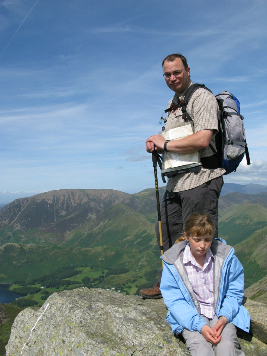 Disheartened daughter cannot work out why Ordnance Survey maps keep leading her father up to the top of hills. Lake District, again, 2009