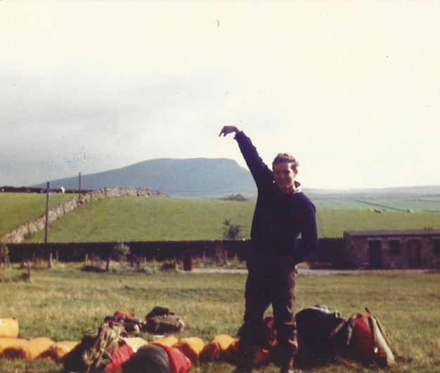 In the 1980s, with friends I scaled hills and mountains in various regions of the UK. My pal Kenny Emerson points out Scafell Pike, soon after we had finished running up and down it- Ordnance Survey had, needless to say, shown the way