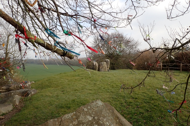 Close to the Pilgrims Way, another path briefly encountered, the Countryway passes by Coldrum Long Barrow. A Neolithic burial chamber of about 2500 B.C. It still attracts the attention of more modern day folk, who have adorned the nearby trees with trinkets and letters