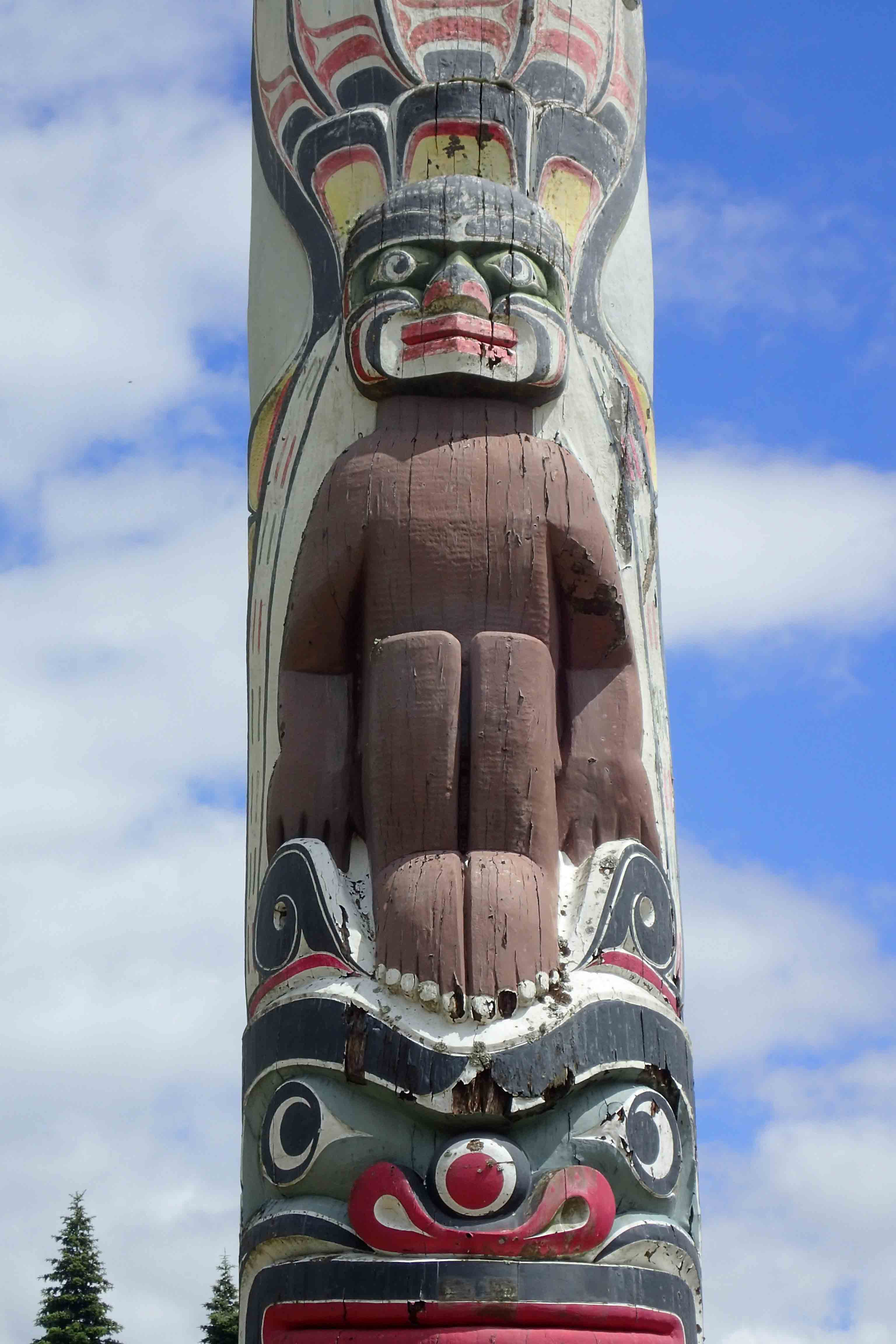 Halibut Man, on Totem Pole at Virginia Water. 100 feet high, the 600 year old log of Western Red Cedar was carved by Kwakiutis and erected in 1958 to mark the centenary of the establishment of British Columbia as a Crown Colony