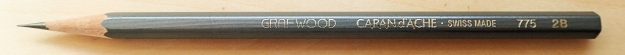 The understated Swiss made Caran d'Ache Grafwood pencil is a good choice. Each pencil is a different shade of pencil to reflect its grade of graphite. If taking a number of these, this makes it easier to select the desired grade at a glance. This is a 2B