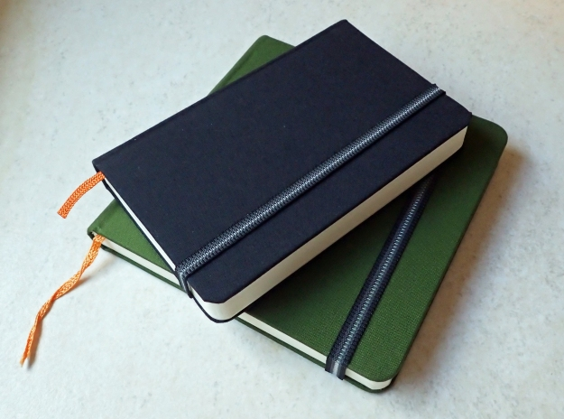 "The Hand Book sketchbooks manufactured by USA based Global Art Materials. The two shown are from the travelogue series and feature hard bound durable covers. Each has 128 pages of 130gsm paper. The elastic closure is useful as is the small pocket in the rear of each. The Pocket Portrait book measures 138mm x 89mm (5 1/2"" x 3 1/2"") and weighs 143g, the Square volume (which I especially like) measures 137mm x 137mm (5 1/2"" x 5 1/2"") and weighs 231g The books come in a wide ranges of cover colours. These are the lighter weight artists journals that will take a light wash. There are also heavier weight 200gsm watercolour journals in the same series"