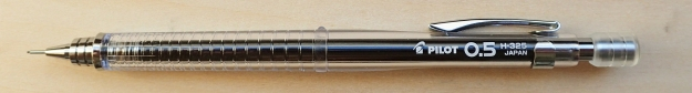 A much lighter mechanical pencil option than than the Pentel GraphGear is the Pilot 0.5 H-325. A fairly cheap but reliable well made an efficient offering. This plastic, clear bodied pencil weighs 11g, or you can knock off a gram by removing the superfluous pocket clip