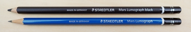 Staedtler Mars Lumograph 2B and Staedtler Mars Lumograph Black 2B. Made in Germany, both of these pencils are made to a high and consistent standard. While the smooth Mars Lumograph has the usual 'graphite sheen' on the paper, the Mars Lumograph Black has a high percentage of carbon added, giving a matt, black shading