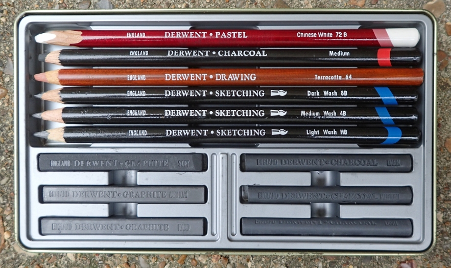 while it is great fun to track down and practice with different mediums and mix and match to form your own set, some useful sets are produced by many manufacturers. The twelve piece Sketching set from Derwent contains three water soluble sketching pencils, a medium charcoal pencil, terracotta drawing pencil and a chinese white pastel pencil. The three compressed charcoal and three compressed graphite sticks, in a variety of tones, also included, are perhaps less practical for the trail. For this reason, the Lyra Rembrant Art Specials set mentioned earlier is probably the better pre-assembled collection for the trail