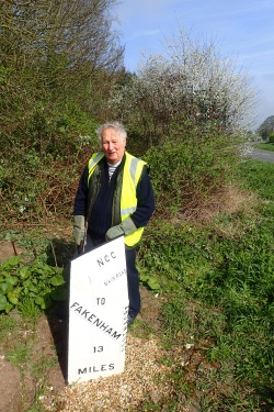 Tony Garrod of the Milestone Society was pleased to stop for a chat. Busy cutting back the vegetation around a freshly painted Mile Post dating from c1905, he belied his 82 years and told me of his 'patch' of Mile Posts on the Swaffham-Fakenham road