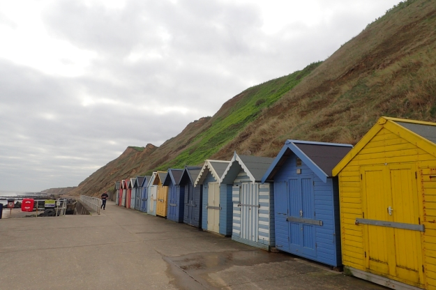 Beach huts below Sheringham Cliffs