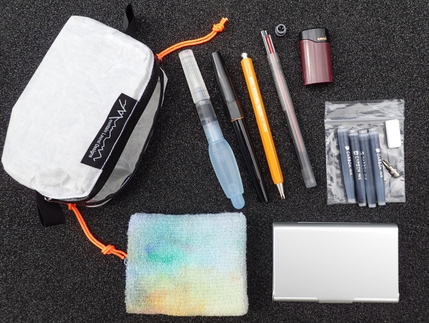 This is my complete art kit for multi-day hikes, other than my journal and a small ball point pen. The entire kit weighs 136g (4.8oz) and contains enough materials to last me many weeks