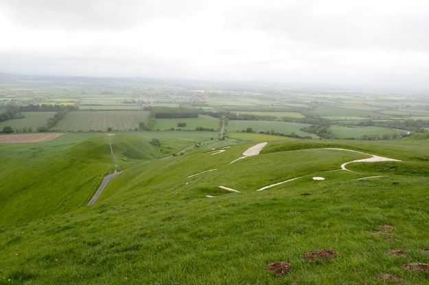Just about the worst place to see a chalk-hill figure is standing next to it. Three Points of the Compass passed the top of Uffington Horse, cut into White Horse Hill, on the Ridgeway in 2016