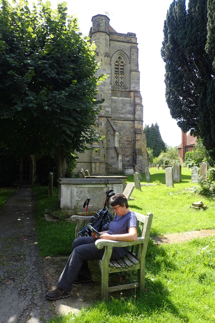 Mrs Three Points of the Compass takes a break on the Wealdway while the 'expedition leader' explores the interior of St. Mary the Virgin, Speldhurst