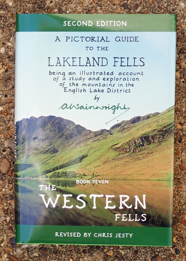 Alfred Wainwright's pictorial guide to the Western Fells. Buttermere with Haystacks beyond. His ashes were scattered on its summit