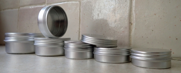 Small aluminium screw top tins are easily available. These are fives of the many sizes on the market. 15ml- 4.5g, 25ml- 6.3g, 30ml- 7.6g, 50ml- 10.1g and 80ml- 14.3g. They can be easily dented and knocked around due to their thin metal, but still hold up well