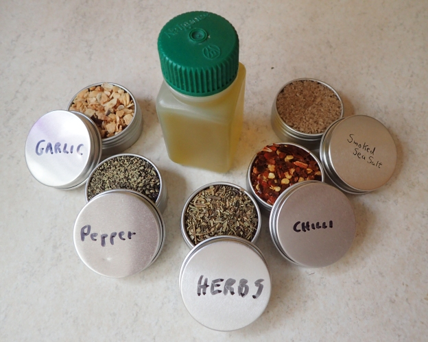 A small selection of herbs, spices and condiments goes a long way to improving bland trail meals