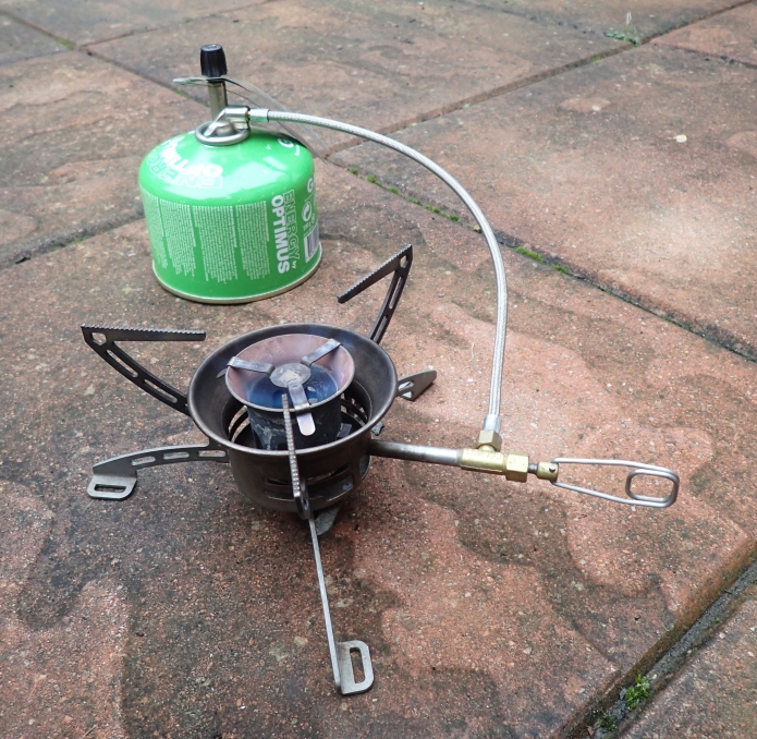 Primus Omnifuel in use with gas canister. Note that jets had to be changed for use with liquid fuels and the fuel bottle and pump are not shown in this image