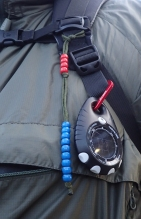 Brunton Pro hanging from pack daisy loop