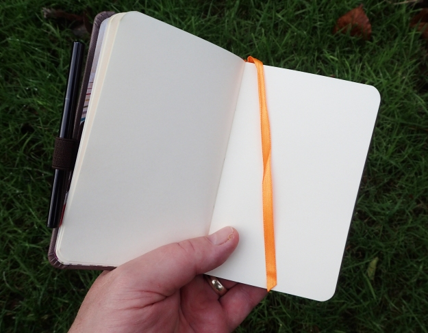 Rhodia rhodiarama notebook in the hand. This makes an excellent journal for longer trips due to it being robust and well made with quite heavyweight pages and hard covers. Far lighter options are available but will have less pages and are more likely to come apart over time