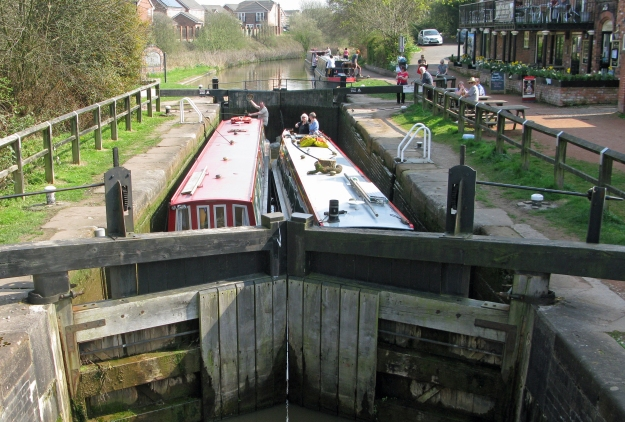 Three Points of the Compass has not only walked the tow path of many a canal, but has also enjoyed many a mile by boat. Here he navigates a lock, with hat aloft, on the Cheshire Ring in 2015