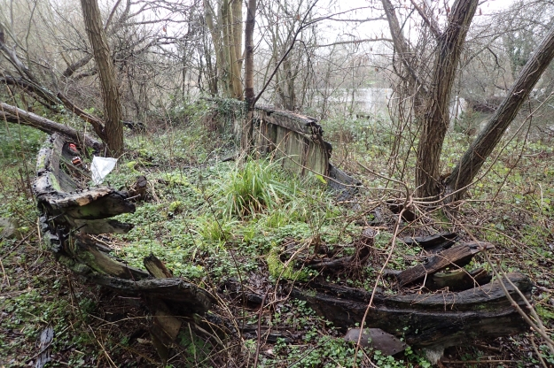 Signs of failure, decay and lack of use can still be found in and alongside many canals today. The rotting carcass of a wooden boat was passed by Three Points of the Compass when walking the London Loop in 2016