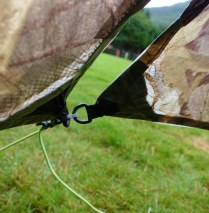 Fraying, strained and worn tie out points on tent vestibule