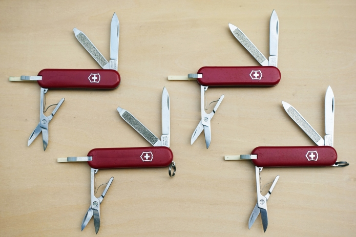 The Victorinox 58mm Classic was a development of the earlier Bijou that lacked a keyring. A further variant on both Bijou and Classic was the addition of a flat 'SD' screwdriver tip to the nailfile. All of these knives come with tweezers and toothpick in the red cellidor scales