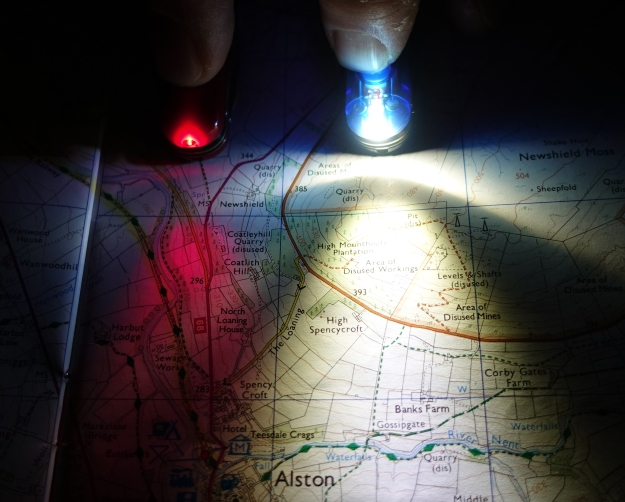 The earlier red LEDs, shown here in Midnight Manager, were later replaced with brighter white LEDs, also shown here in a Midnight Manager. White headtorches are carried by most hikers and Three Points of the Compass feels the small red LED is of more use in conjunction with the main white light