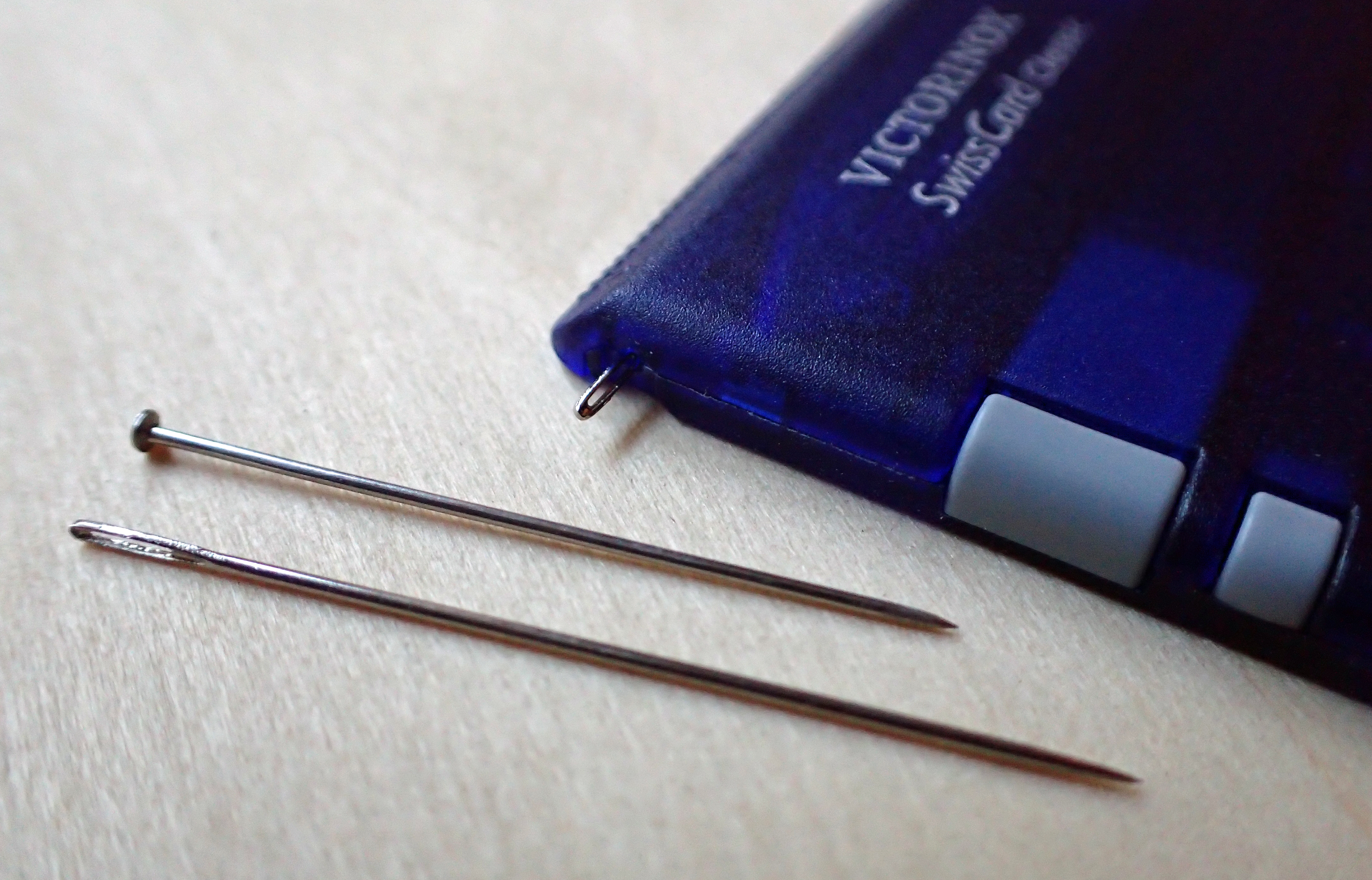 One option with a SwissCard is to replace the pin with a needle. This replacement is a Size 7 embroidery/crewel needle
