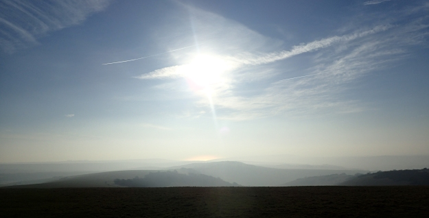 Looking south from atop the South Downs, the English Channel can just be seen on a misty cold morning