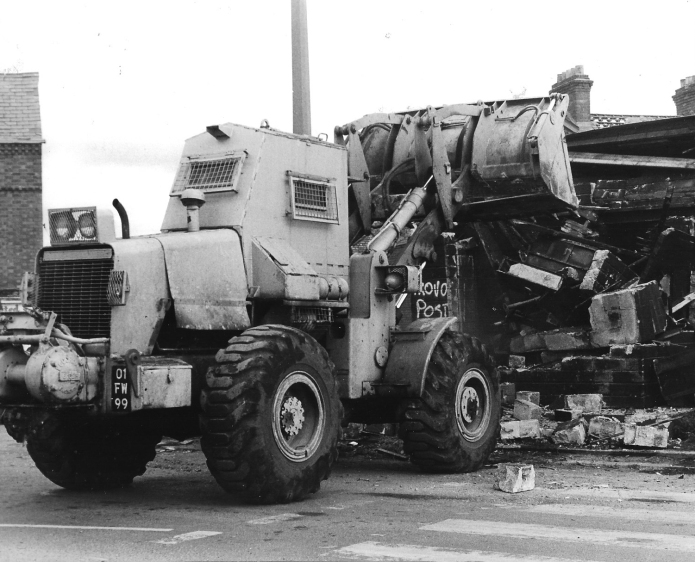 1984 and 1985 was spent in Northern Ireland. There was little room in the cramped cab of an armoured Allis Chalmers wheel loader. Occasionaly an SMG could be thrown behind the seat while working, but invariably, all that we were armed with was our clasp knife