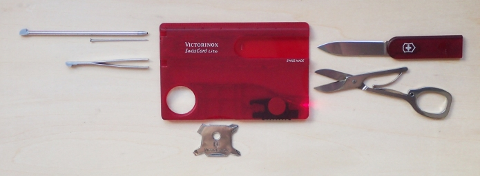 First generation of SwissCard Lite with red LED, card case in translucent red