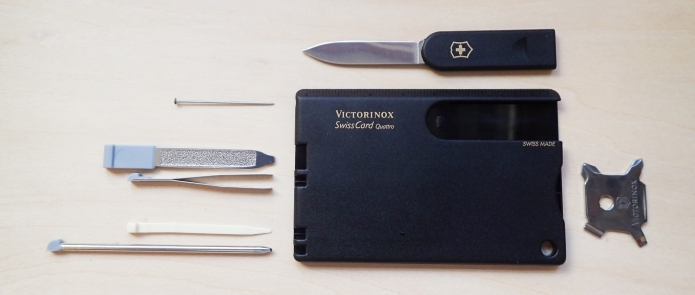 Victorinox SwissCard Quattro in solid black. While the addition of the new four-way screwdriver was a welcome addition, the loss of scissors in the SwissCard Quattro means that there is some wasted storage space in the plastic holder of this version that could have been utilised by Victorinox