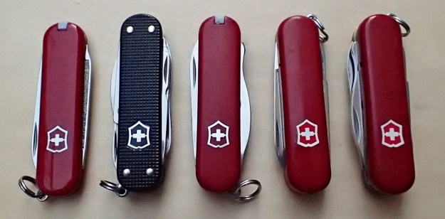 Top five Victorinox 58mm knives. The Midnite Manager with red LED, my number one choice, is far right