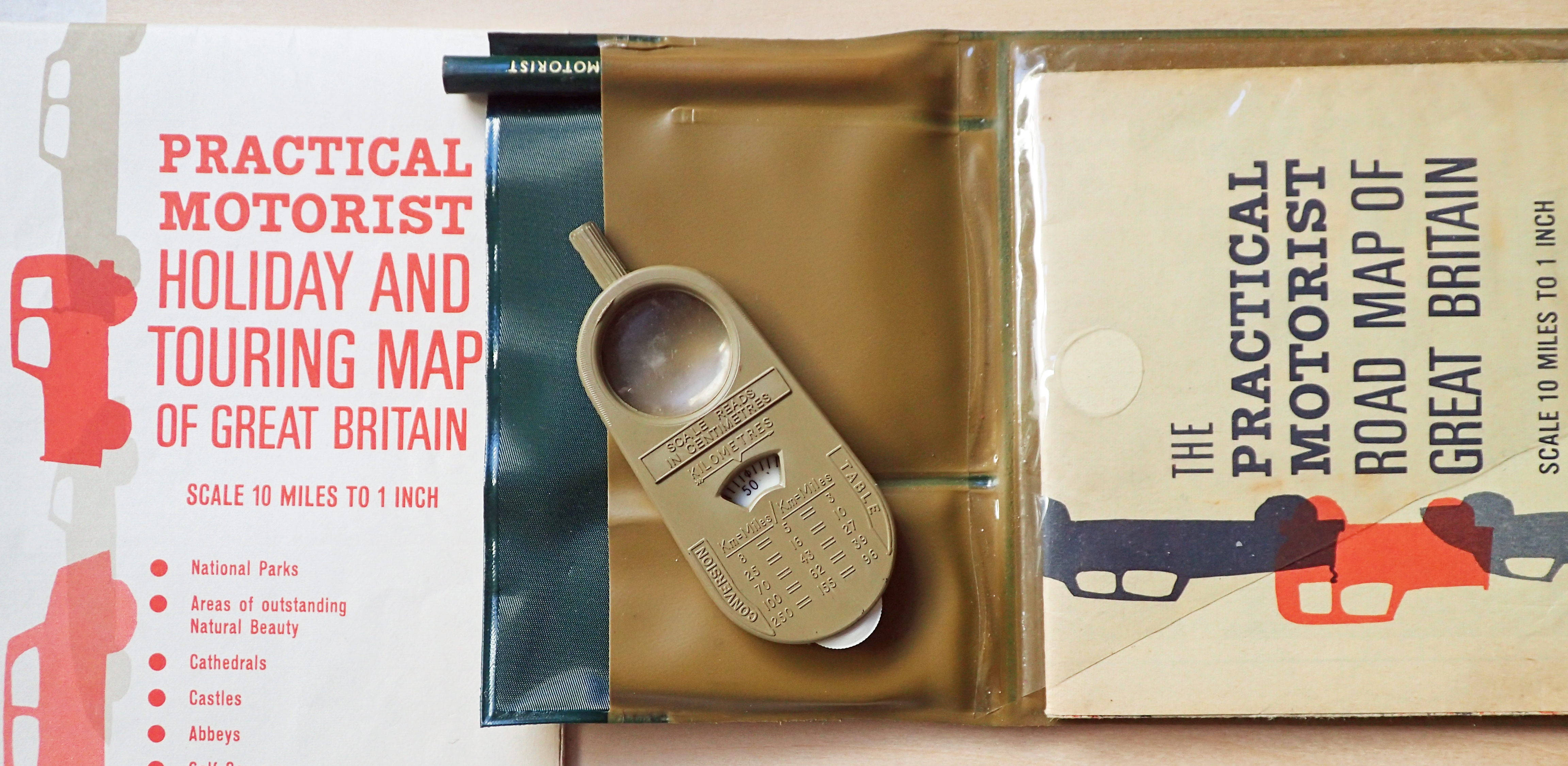 Practical Motorist map case, road and tourist maps, pencil and map measurer, 1964