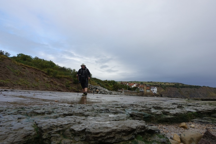 With a low tide, it is easy walking out of Robin Hoods Bay at the foot of the cliffs