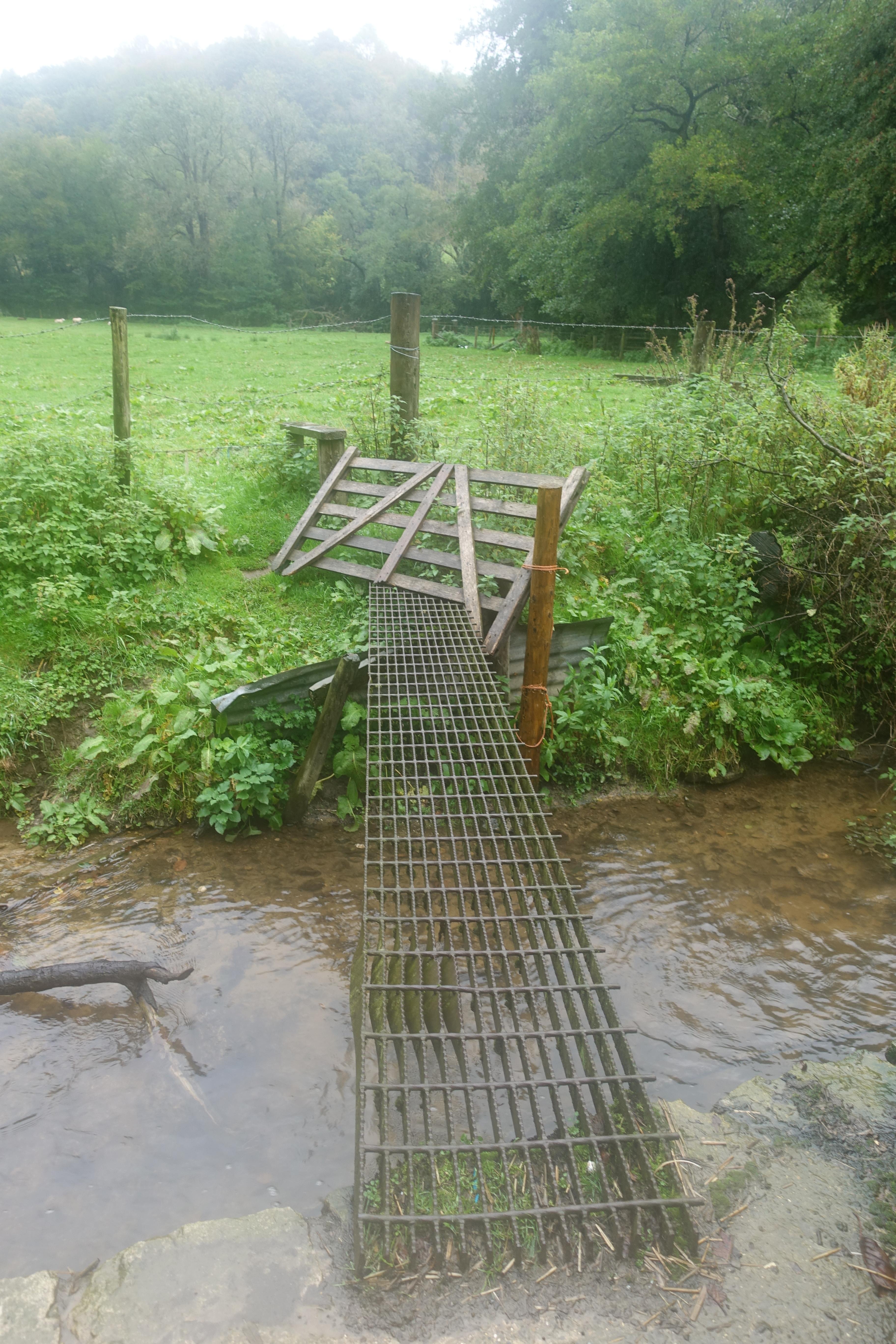 Dodgy bridge takes the hiker into a dodgy farmyard