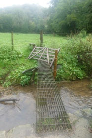 Dodgy bridge takes the hiker into a dodgy farmyard