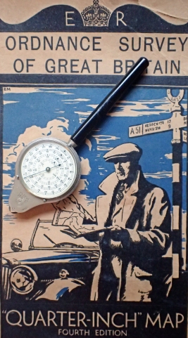 Map measurer by Henri Chatelain, with Quarter-Inch Ordnance Survey map to The Border, 1935