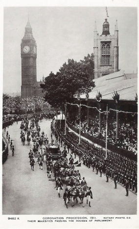 The crowds gather to view the coronation procession in 1911. Rotary Photographic Series postcard