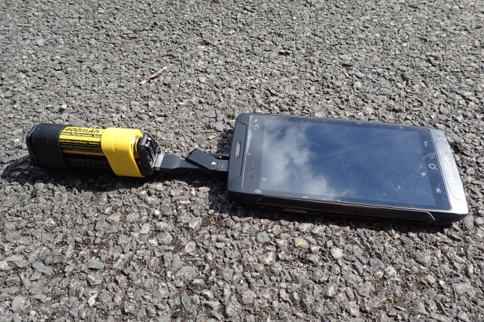 Charging phone on trail with Nitecore F1 battery charger/power bank