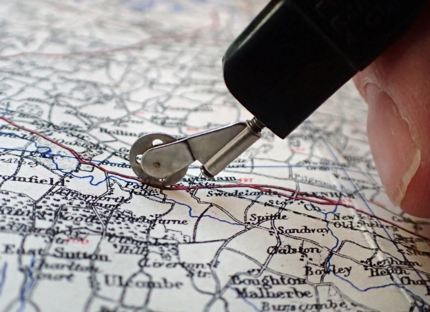 Simple to use, the little wheel is trundled along a line on a map, clicking every quarter mile